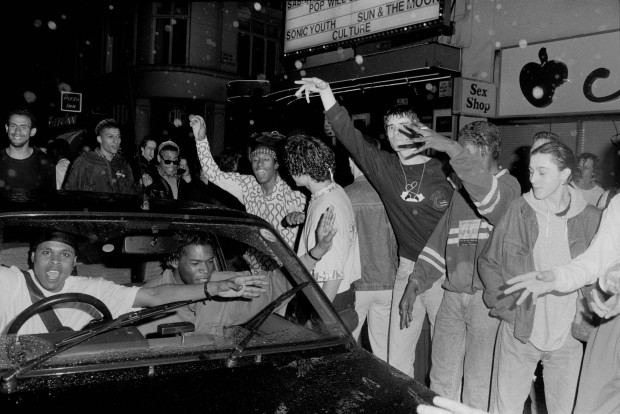 Ravers dancing outside 'the Trip' at the Astoria London 1988 - Museum of Youth Culture (C) Marcus Graham